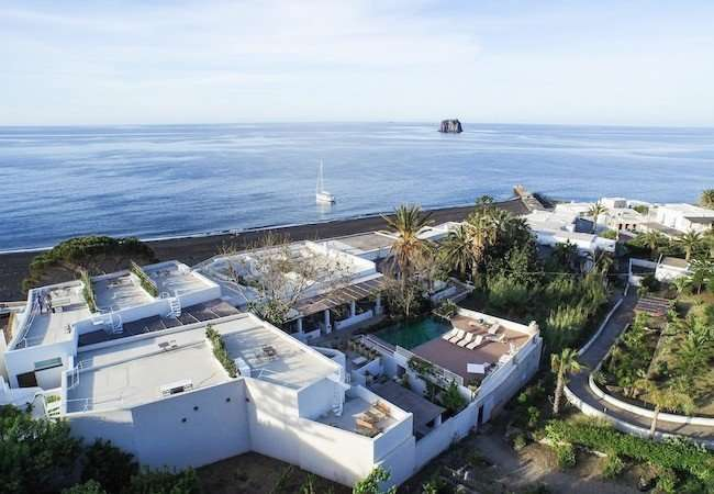 The gabbiano relais stromboli viewed from the drone with sea and strombolicchio